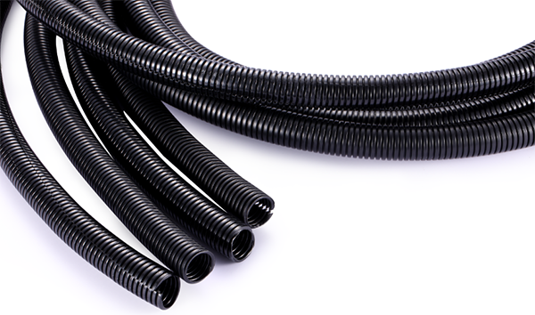 How is corrugated hose used in wiring harness